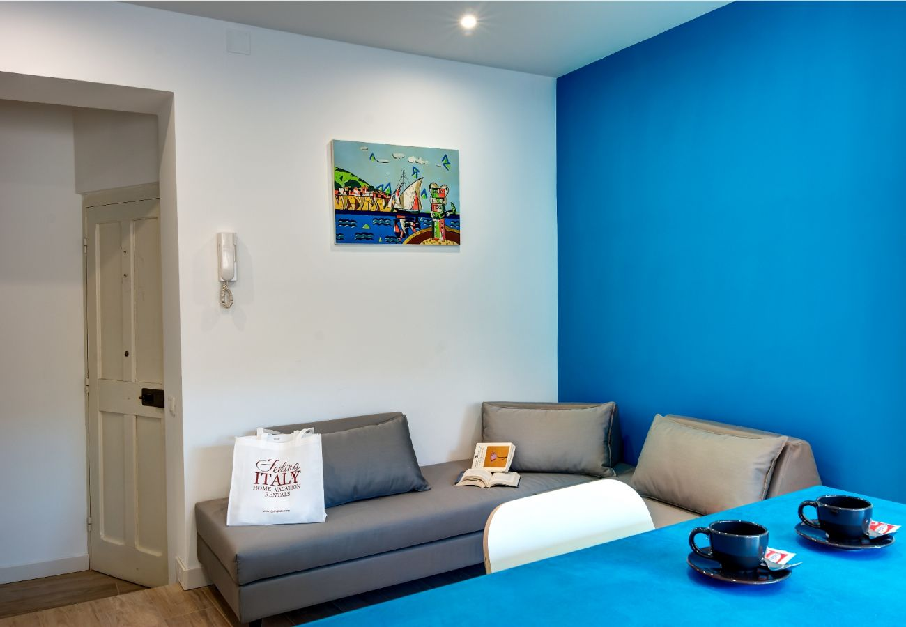 living room with double sofa bed, balconcino holiday apartment sorrento, italy