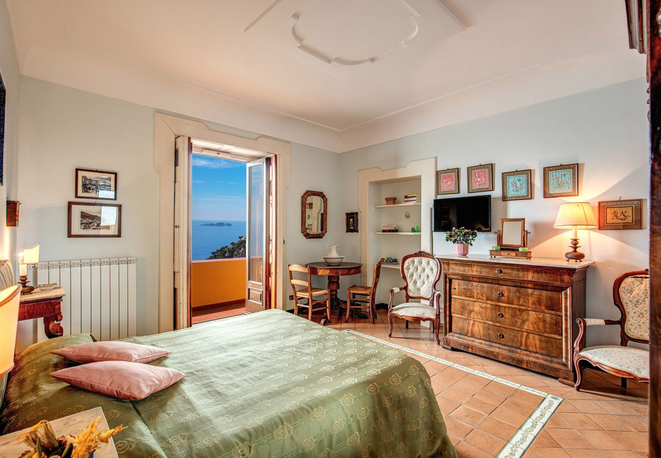 classic double bedroom with sea view balcony, sunny day, holiday home positano