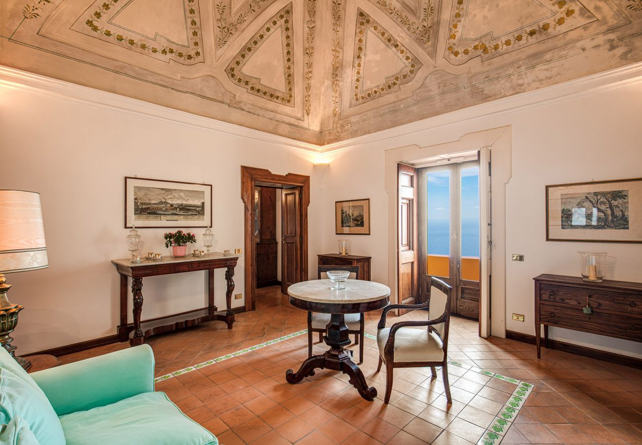 classic elegant living room with frescoes, casa marina positano