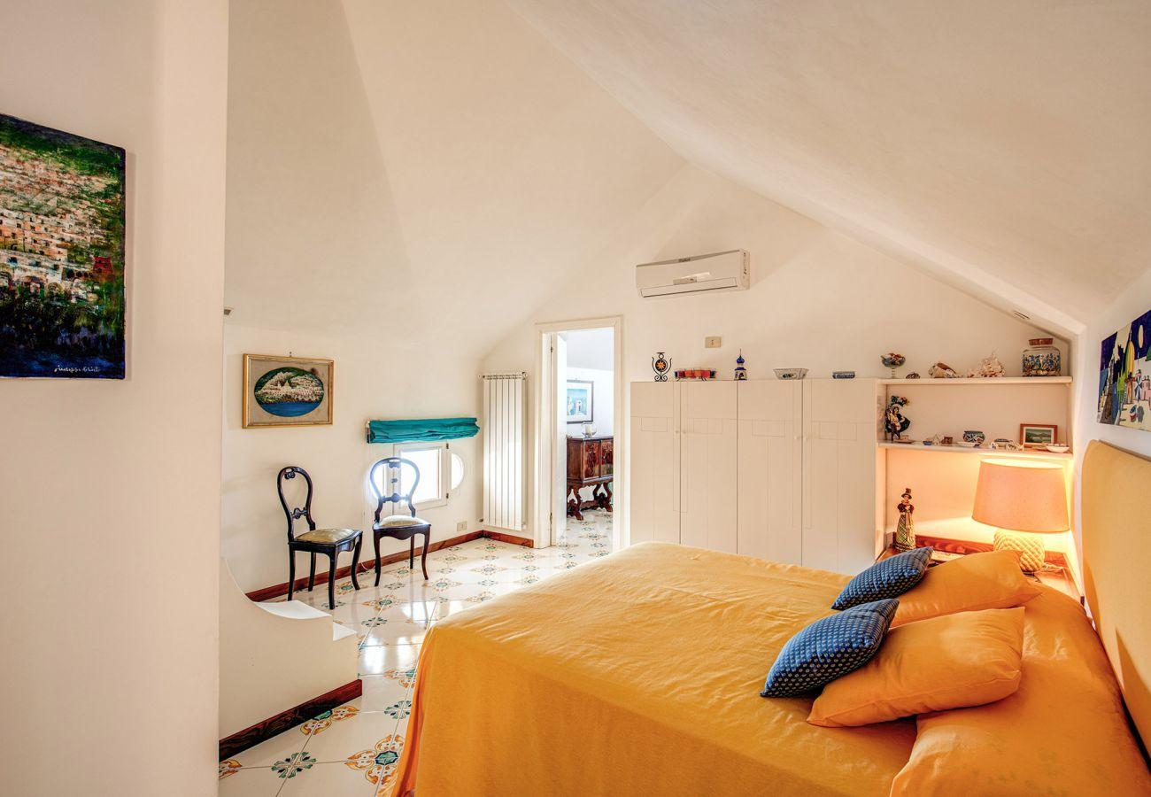 one of three bright double bedroom, in orange, holiday home casa marina positano