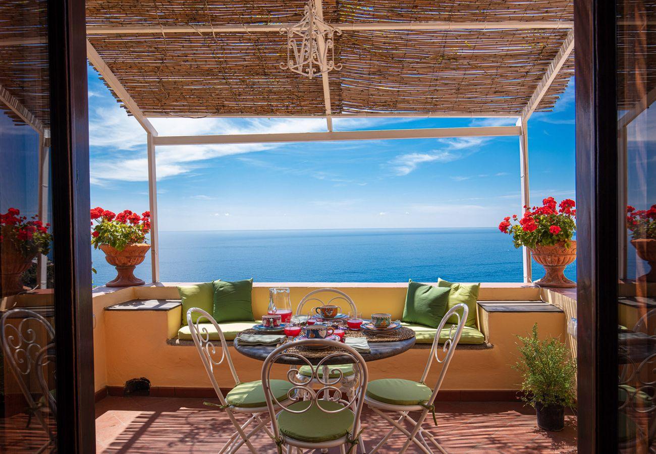 furnished terrace with sea views, sunny day, casa marina positano